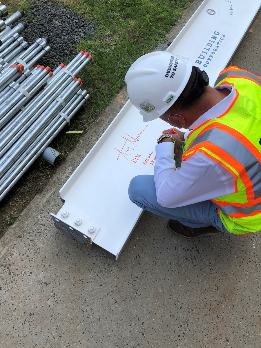 Man signing a support beam